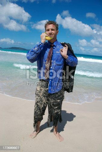 658516626 istock photo Smiling Castaway Businessman Talks on Banana Phone 172689927