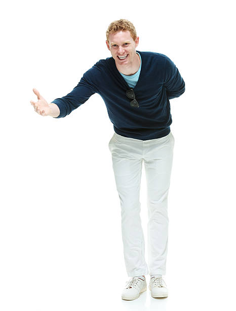 Smiling casual man bowing stock photo