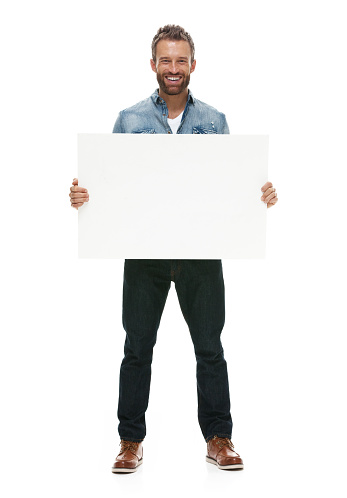 Smiling casual man holding placardhttp://www.twodozendesign.info/i/1.png