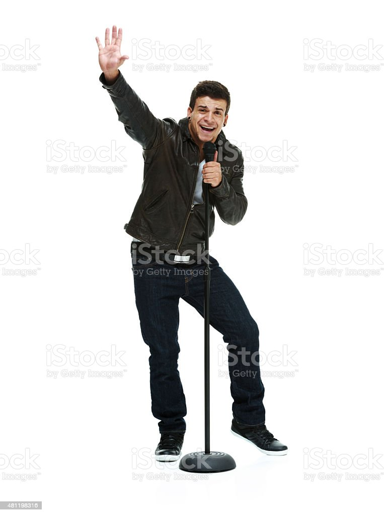 Smiling casual man singing song with microphone stock photo
