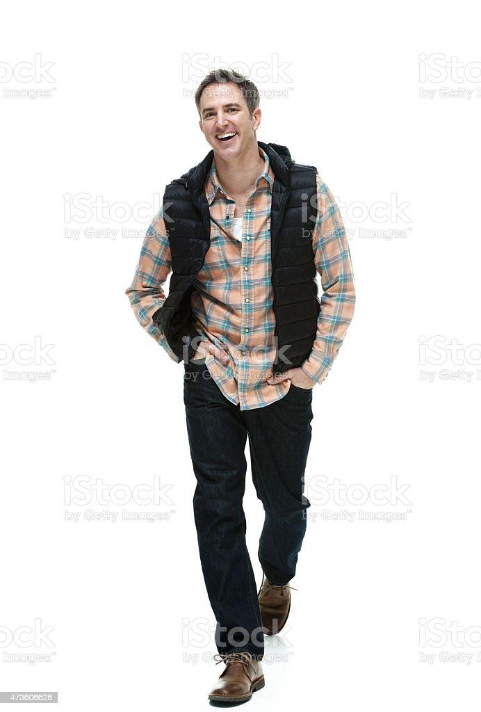 Smiling casual man walking stock photo