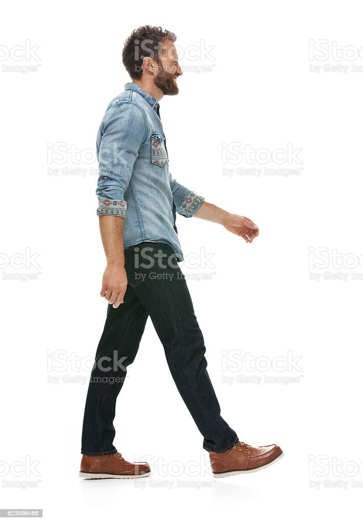 Smiling casual man walking stock photo