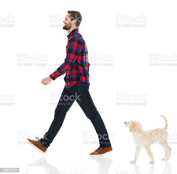 Smiling casual man walking with his puppy picture id598226222?b=1&k=6&m=598226222&s=612x612&h=jez vl6mqph0mn199zzfxsoqpdjapkztzeyveak1ank=