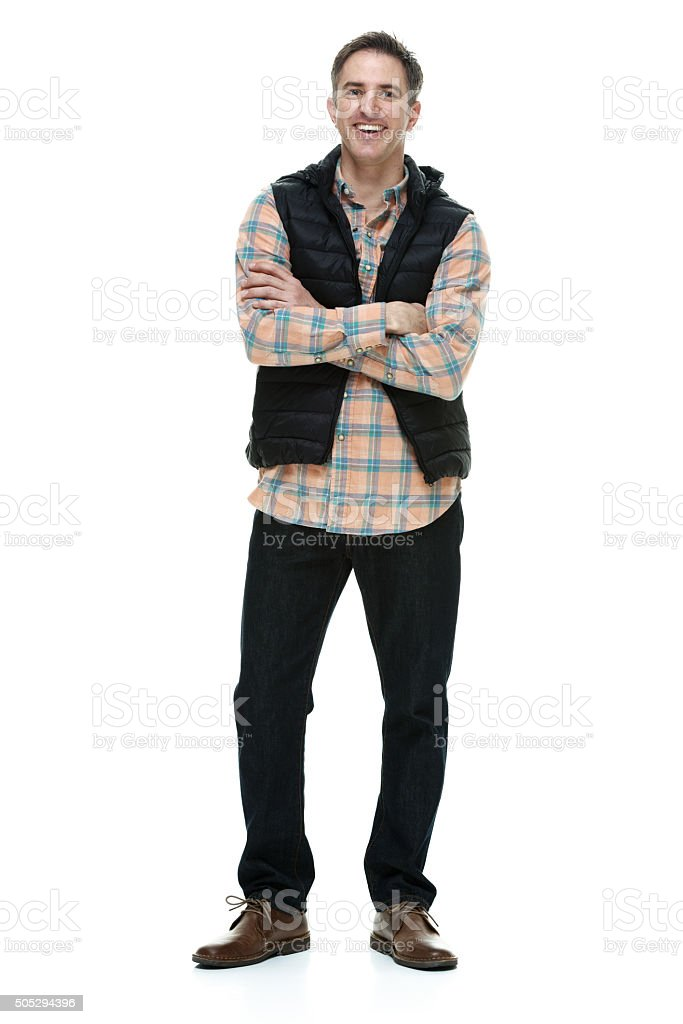Smiling casual woman standing with arms crossed stock photo