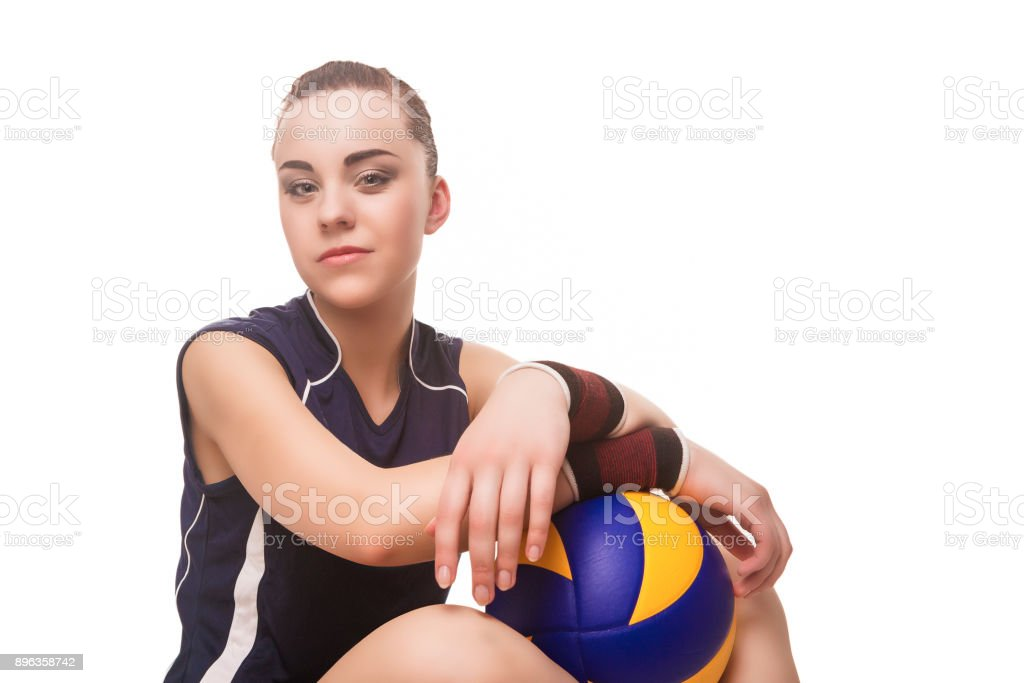 Smiling Caucasian Professional Female Volleyball Player Equipped in Training Outfit with Ball. stock photo