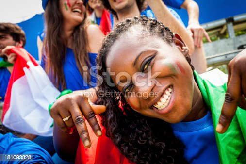 537894724 istock photo Smiling Cheering Black Woman and Italian Footbal Team Supporters 181093828