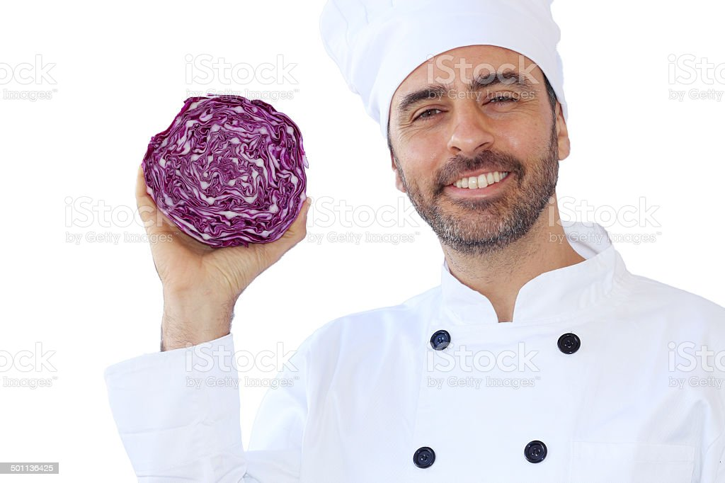 Smiling chef holding a red cabbage stock photo