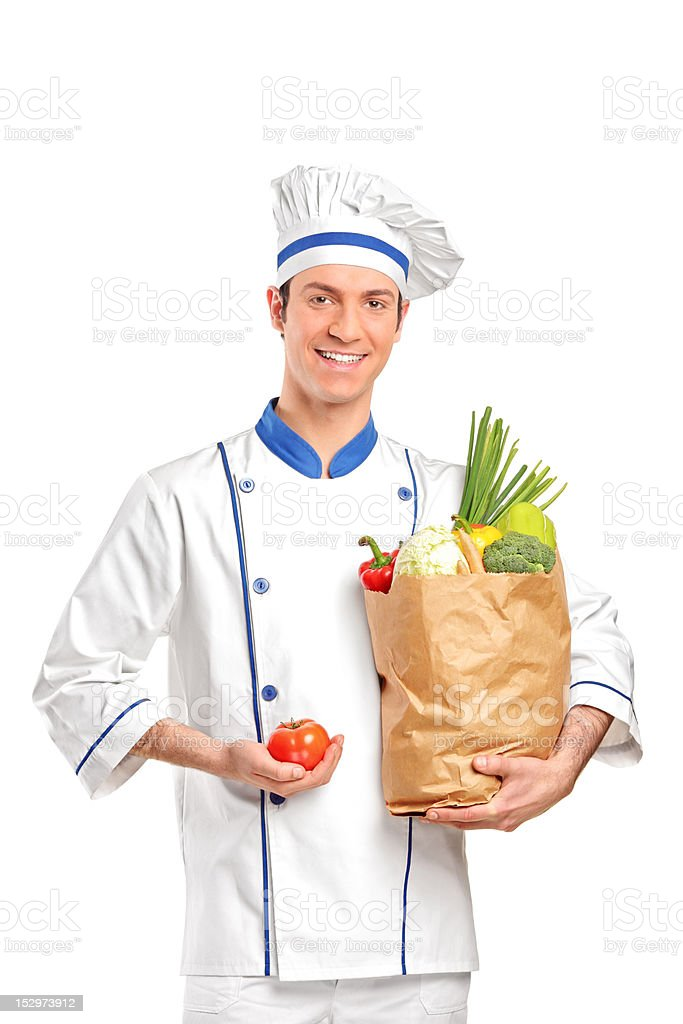 Smiling chef holding a tomato and bag royalty-free stock photo