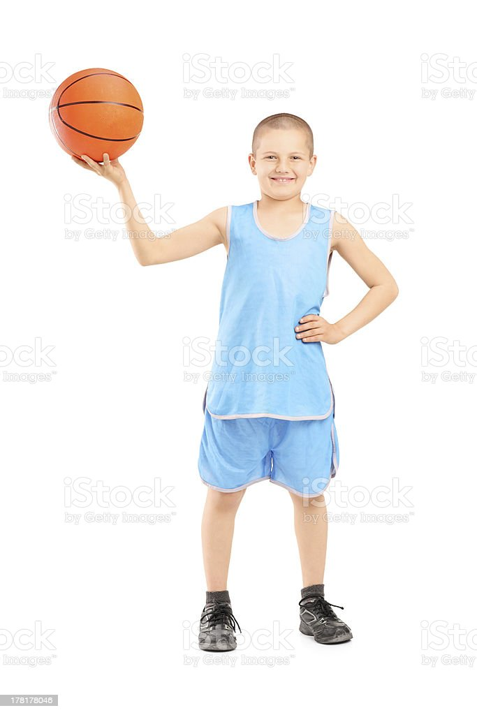 Smiling child holding a basketball stock photo
