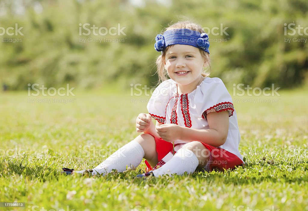 Smiling child in russian folk clothes royalty-free stock photo