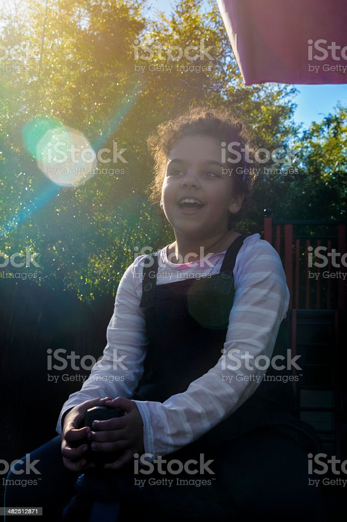 PEOPLE: Smiling Child (7-8) Playing In Playground royalty-free stock photo