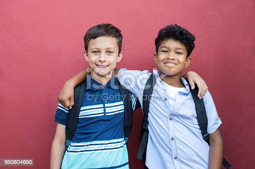 istock Smiling children friends embracing 950604650