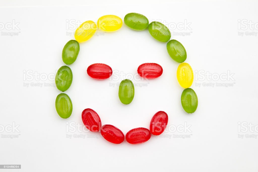 smiling children girl face made of candy stock photo