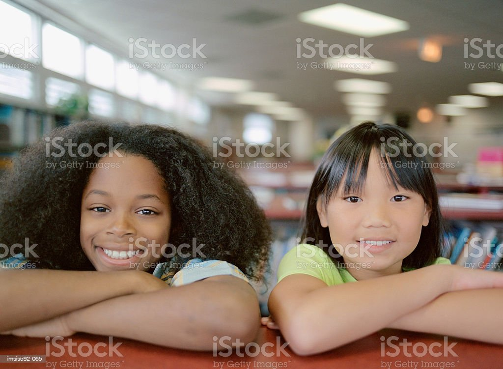 Smiling children in library royalty-free stock photo