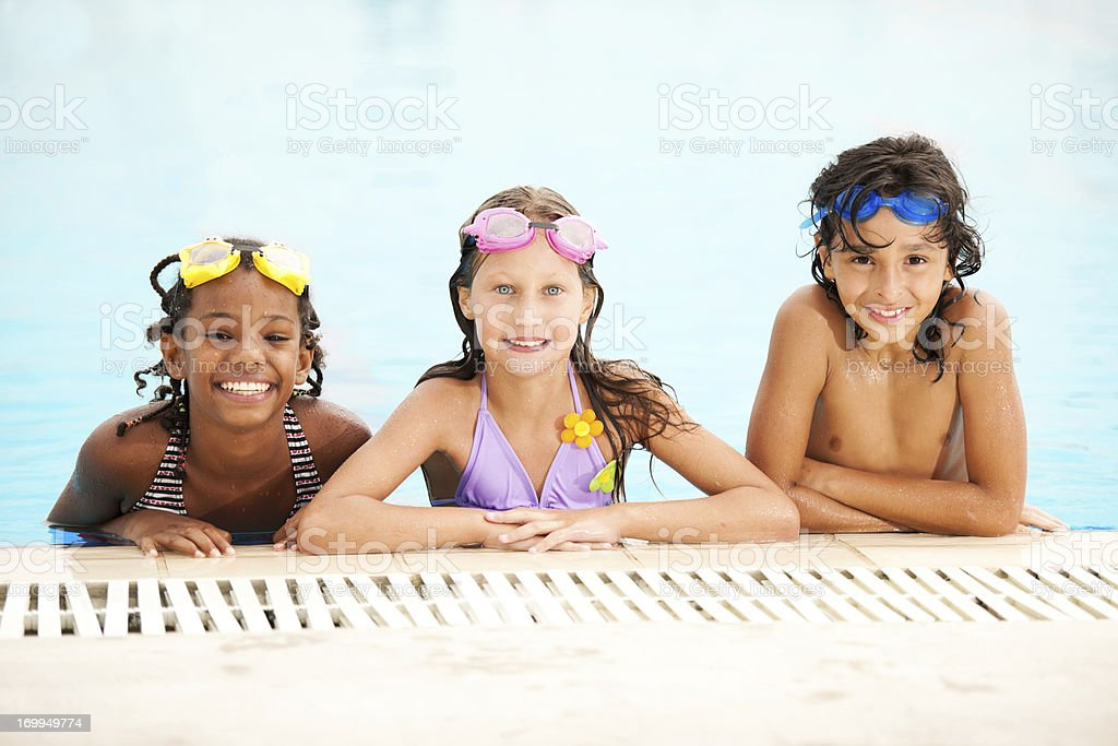 Smiling children in pool. stock photo