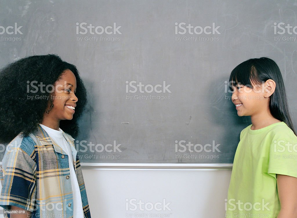 Smiling children near blackboard royalty-free stock photo