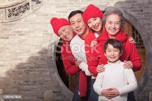Smiling Chinese family celebrating new year