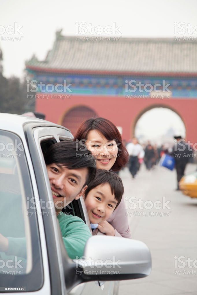 Smiling Chinese family in car