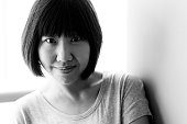 Smiling Chinese girl's black and white photographs