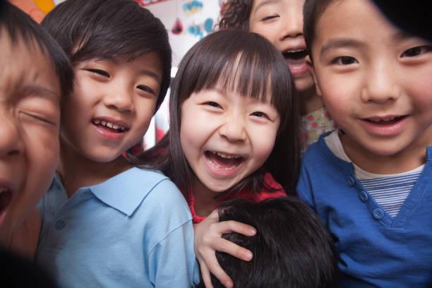 Smiling Chinese kids stock photo