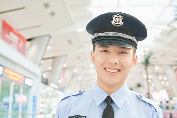 Smiling Chinese policeman stock photo