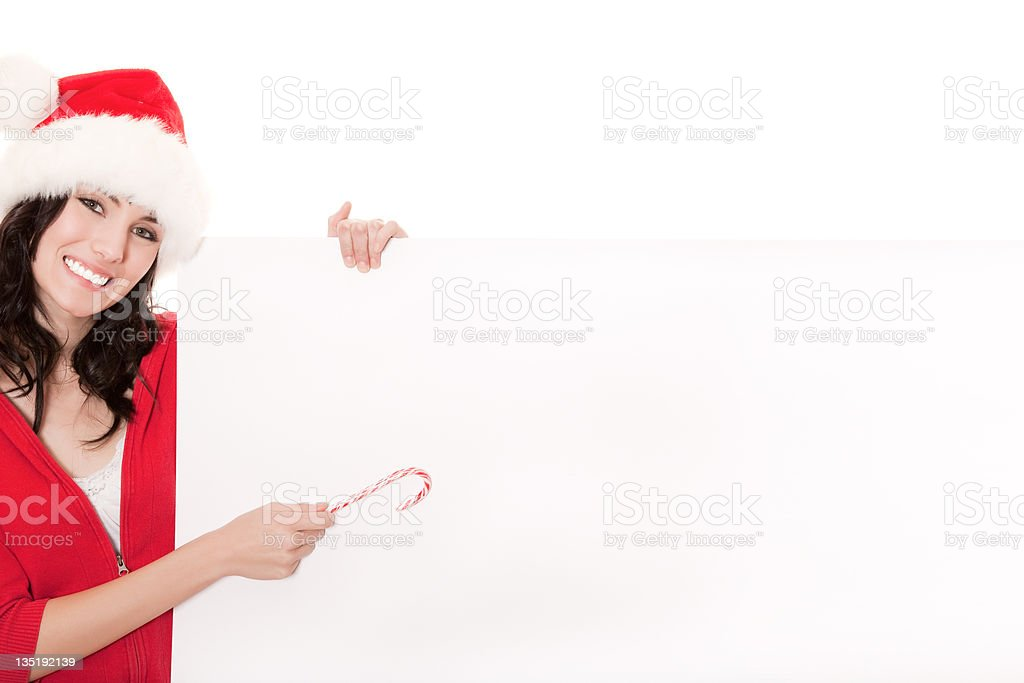 Smiling christmas girl holding blank card royalty-free stock photo