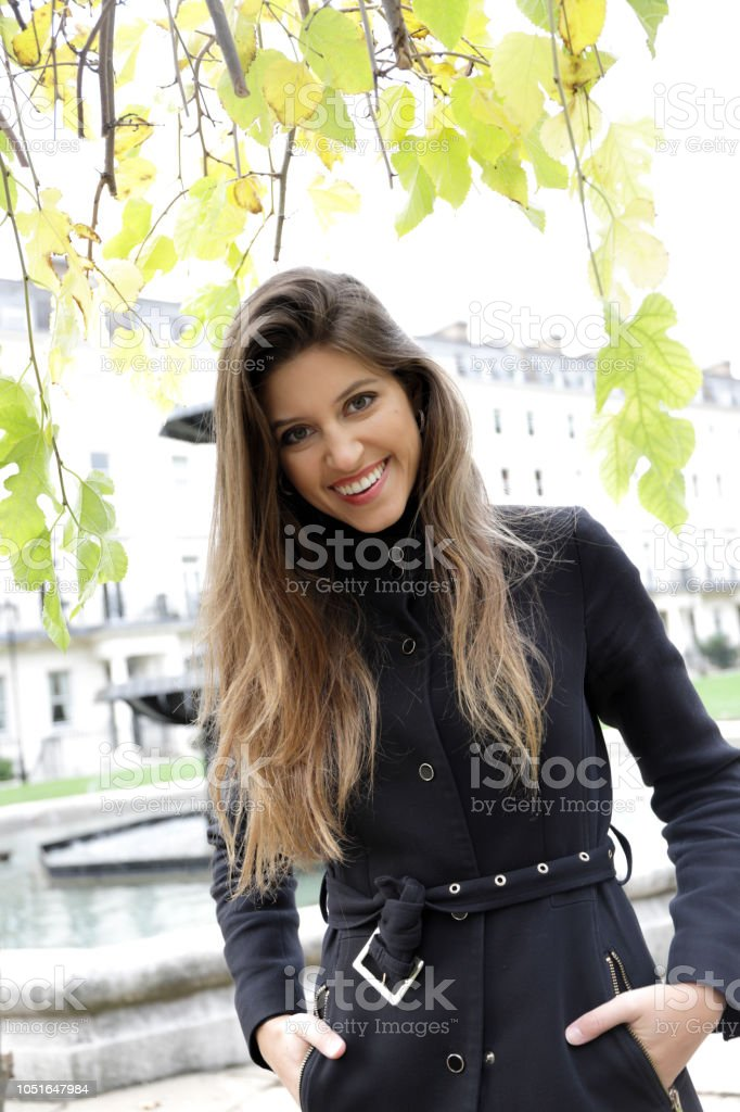 Smiling city fashion London Russian outdoor girl black outfit stock photo