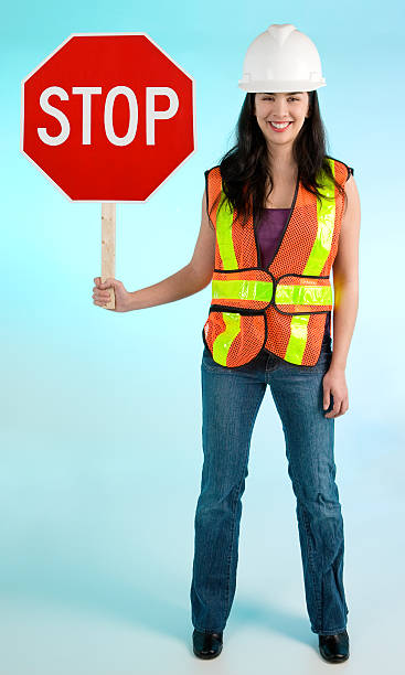 Smiling Conceptual Construction Lady Worker Stopping you For Something stock photo