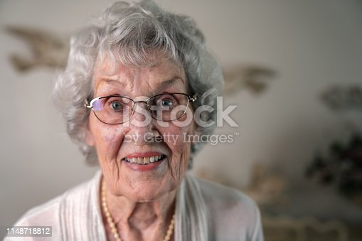 istock A Smiling, Confident 100-Year Old Woman in Her Home 1148718812
