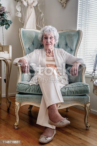 100-Year Old Woman smiling cheerfully and confidently, in Her Home