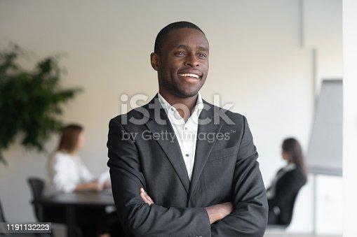 825082848istockphoto Smiling confident african american businessman head shot portrait. 1191132223