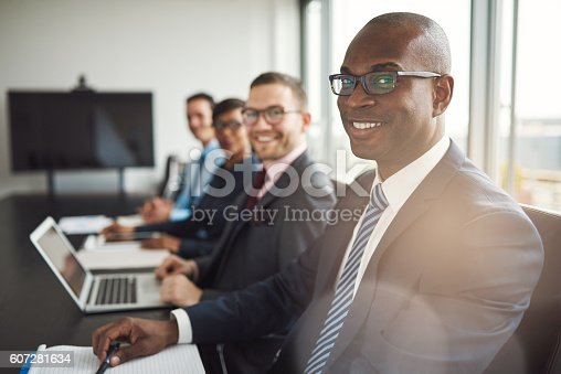 istock Smiling confident African businessman in a meeting 607281634