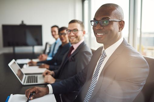 Smiling Confident African Businessman In A Meeting Stock Photo - Download Image Now