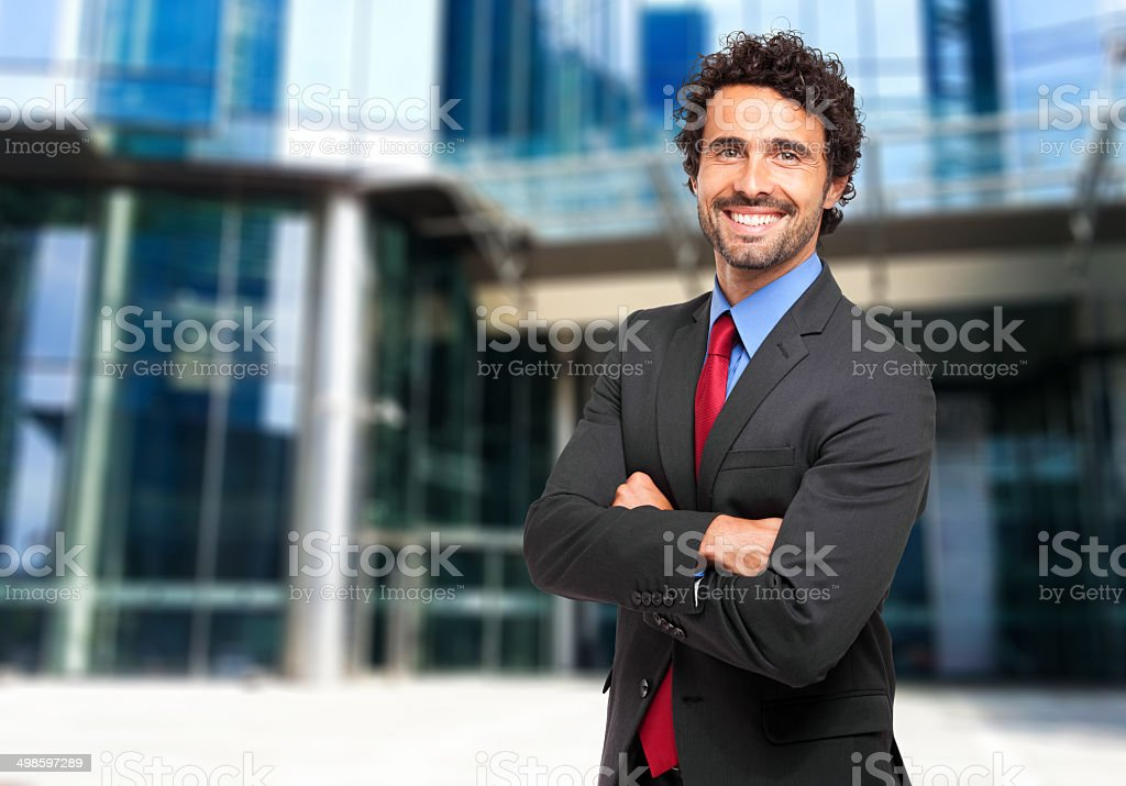 Smiling confident businessman stock photo