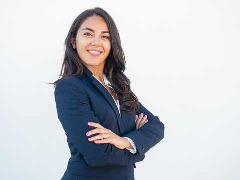 istock Smiling confident businesswoman posing with arms folded 1163294201
