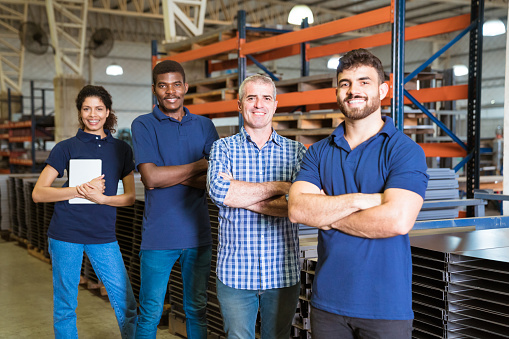 Smiling Confident Workers Standing In Industry Stock Photo - Download Image Now