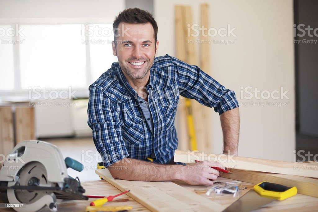 Smiling construction worker at work stock photo