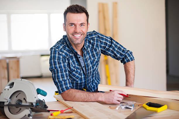 Smiling construction worker at work Smiling construction worker at work  plaid shirt stock pictures, royalty-free photos & images