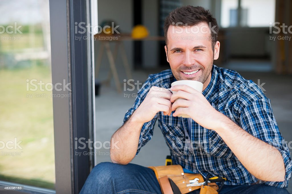 Smiling construction worker during the coffee brake stock photo
