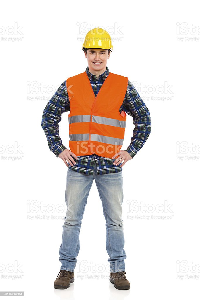 Smiling construction worker posing. stock photo