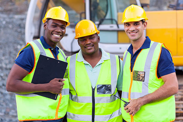smiling construction workers stock photo