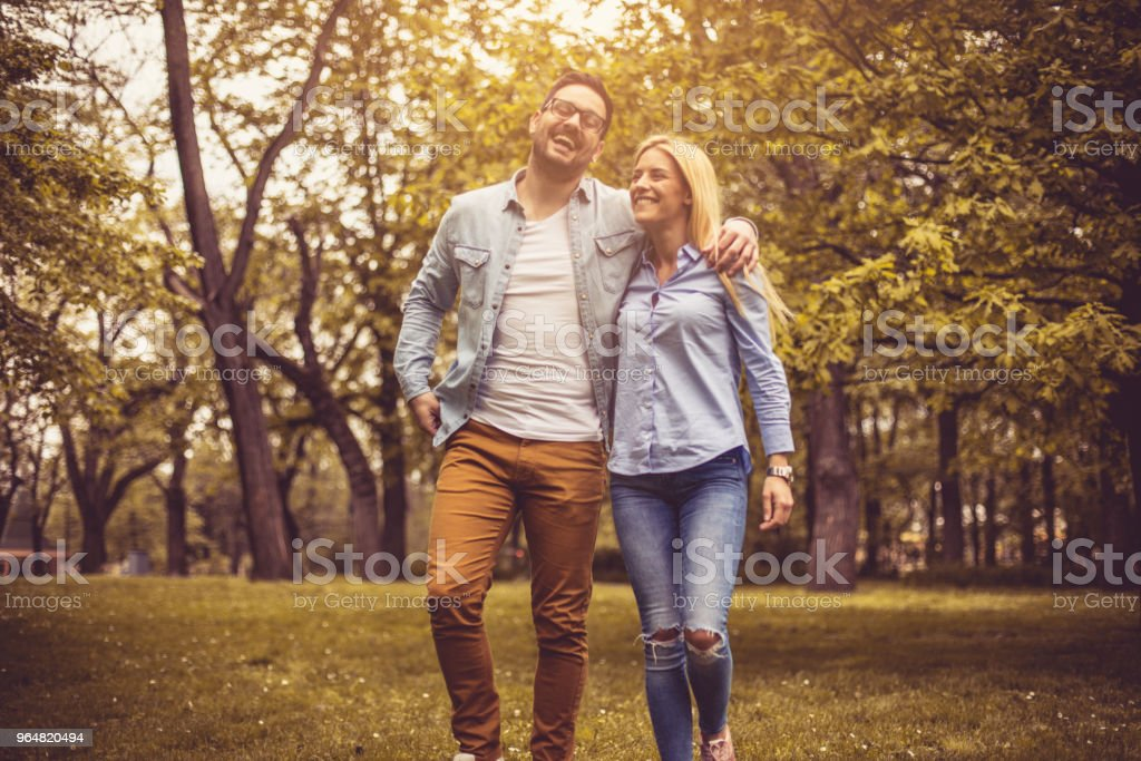 Smiling conversation at park. royalty-free stock photo
