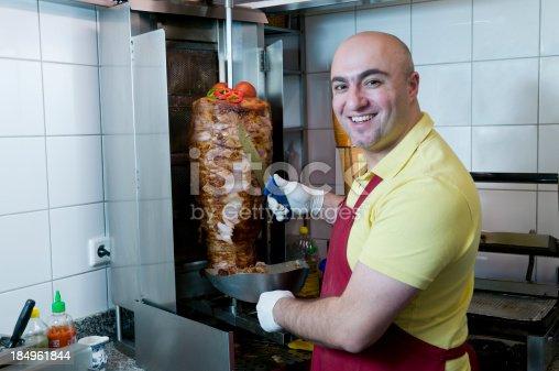 istock smiling cook in doner kebab restaurant 184961844