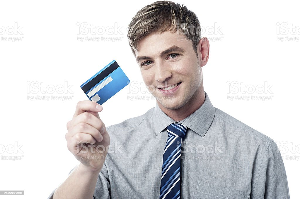Smiling corporate guy showing his debit card stock photo