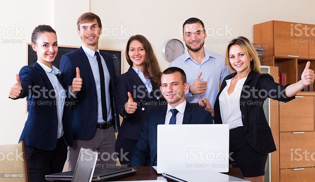 Smiling corporate managers in office interior stock photo