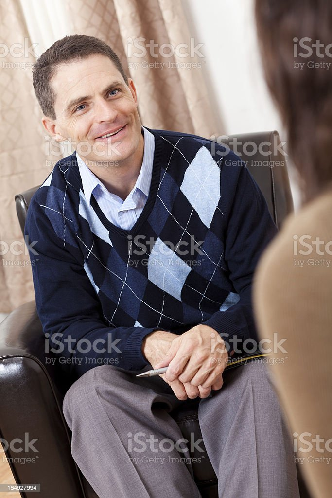 Smiling counselor talking to woman royalty-free stock photo