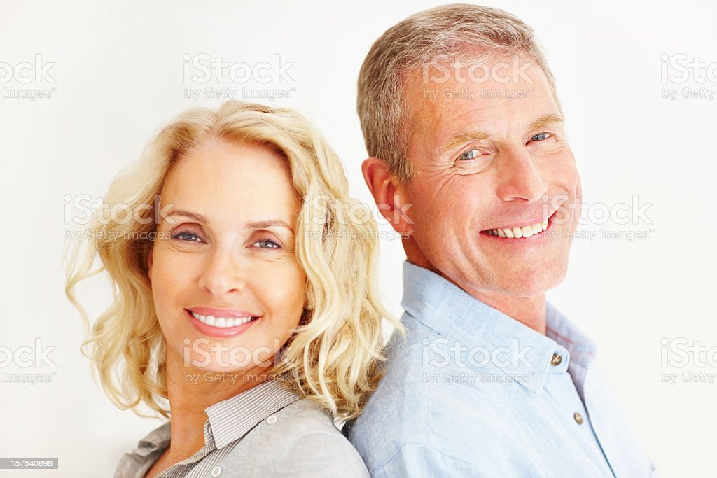 Smiling couple against white background stock photo