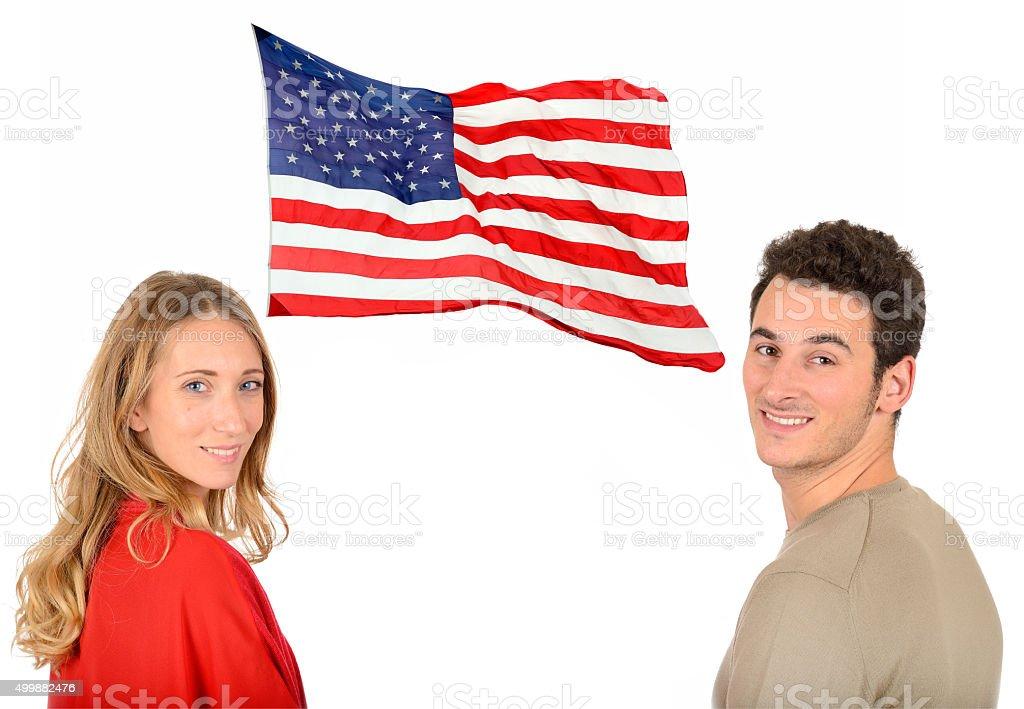 Smiling couple and USA flag stock photo