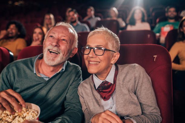 smiling couple at cinema - movie theater stock pictures, royalty-free photos & images