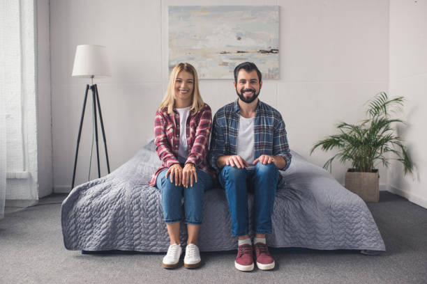 smiling couple at home stock photo